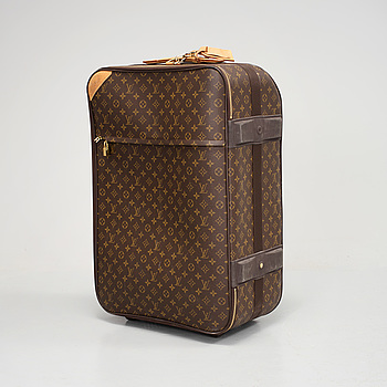 "LOUIS VUITTON, A ""Pégase 55"" Louis Vuitton  suitcase."
