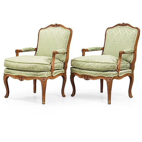 A pair of louis xv 18th century armchairs.