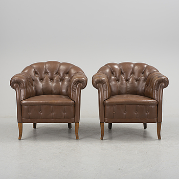 A pair of mid 1900s armchairs.