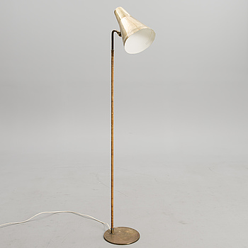 PAAVO TYNELL, A FLOOR LIGHT. Marked Idman.