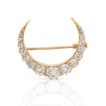 BROSCH, I form av månskära med gammalslipade diamanter totalt ca 2.85 ct. Troligen sent 1800-tal.