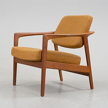 FOLKE OHLSSON, A Folke Ohlsson teak armchair from Dux, 1950's/60's.