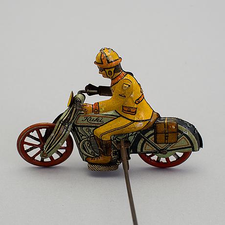 A tinplate huki roundabout motorcycle, germany, 1930s