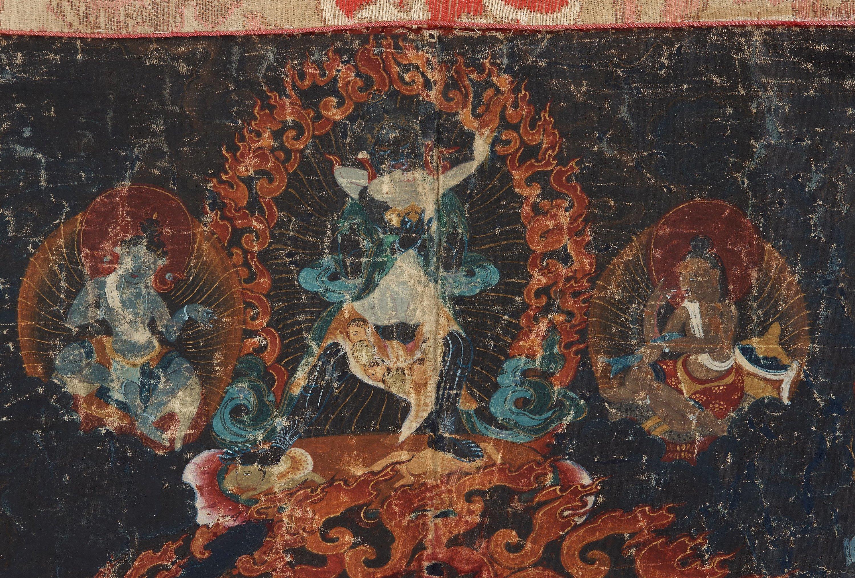 A Tibetan Thangka of Mahakala surrounded by fierce Dharma