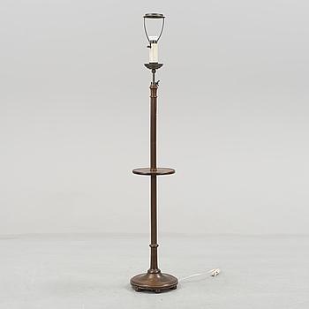 A 20th century mahogany floor lamp.
