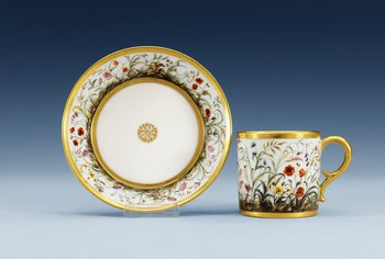 A French Empire cup with saucer, by Dihl. Height of cup 6,3 cm, diameter of saucer 12,8 cm.