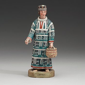 143. A Russian biscuit figure of a man of the Aleut people, circa 1900.