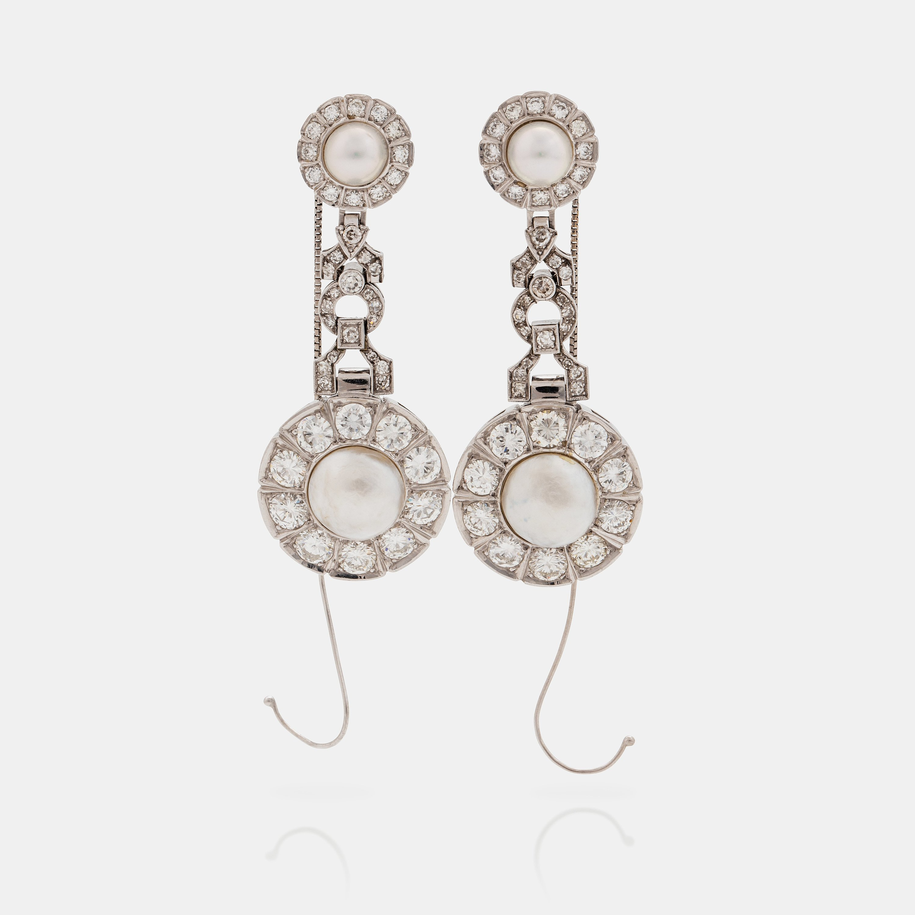 a47e7b33ec738 A pair of probably natural saltwater pearl, cultured pearl and ...