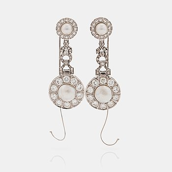 903. A pair of probably natural saltwater pearl, cultured pearl and brilliant cut diamond earrings.