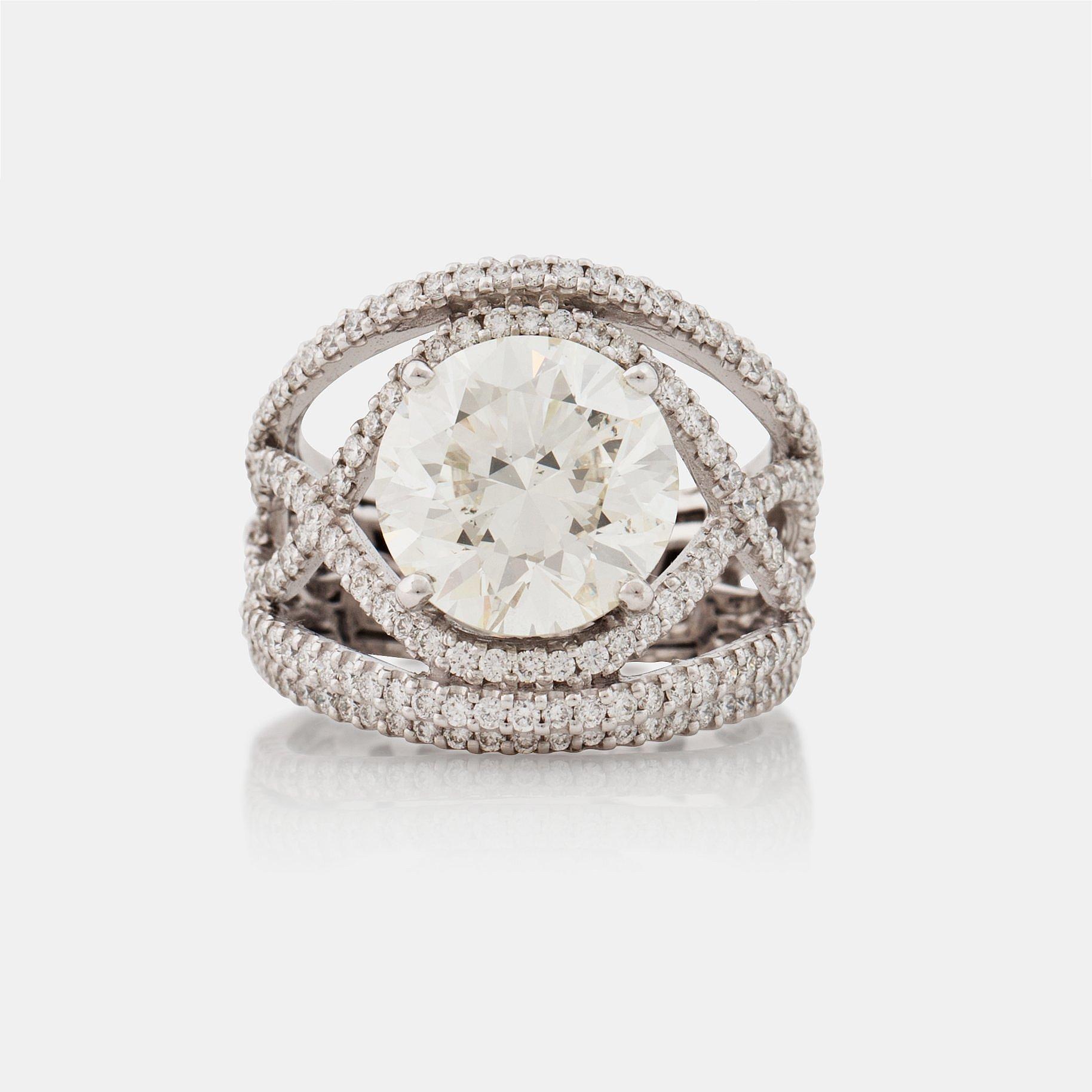 A Brilliant Cut Diamond Ring. Total Carat Weight Circa 8