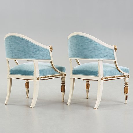 A pair of late gustavian circa 1800 armchairs.