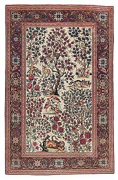 124. A CARPET, a semi-antique Esfahan figural, 215,5 x 140,5 cm.
