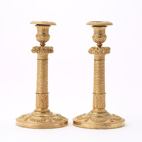 A pair of empire candlesticks.