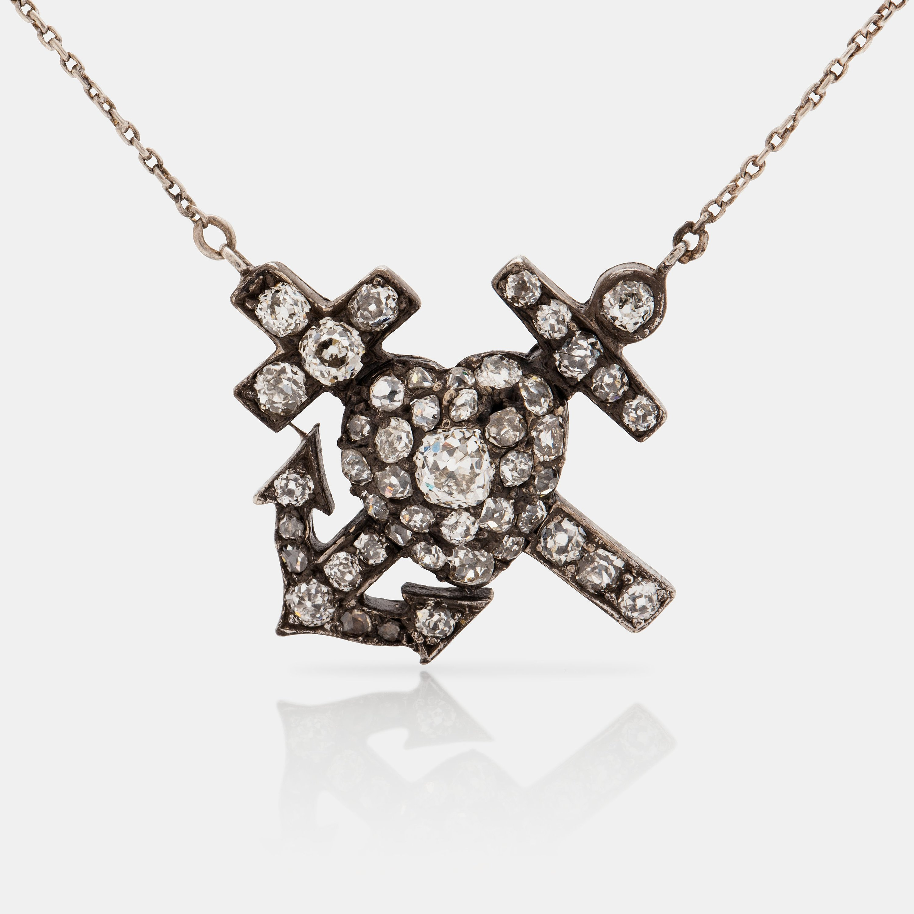 A Necklace With Symbols For Faith Hope And Love Set With Old Cut
