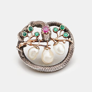 787. A Karl Rothmüller, Art Nouveau serpent brooch, circa 1900, with a ruby, emeralds and probably natural saltwater pearls.