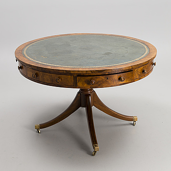 An early 20th century English drum table.