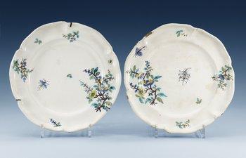 1211. Two faience plates, presumably Strasbourg, ca 1740. (2).