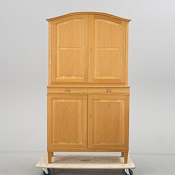 """CARL MALMSTEN, A """"Herrgården"""" cabinet by Carl Malmsten."""