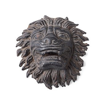 118. Anna Petrus, a cast iron mascaron in the shape of a lion's head.