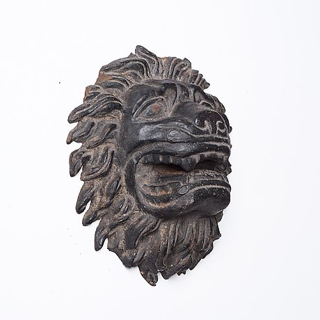 Anna petrus, a cast iron mascaron in the shape of a lion's head.