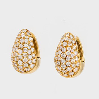 A pair of earrings set with round, brilliant-cut diamonds.