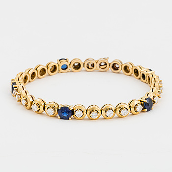 A bracelet set with round, mixed-cut sapphires and round, brilliant-cut diamonds.