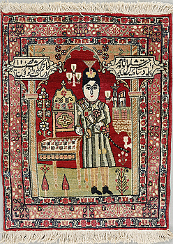 A Kirman rug, semi-antique, ca 78 x 60 cm.