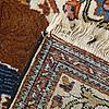 An oriental rug, semi-antique, 77 x 56 cm.