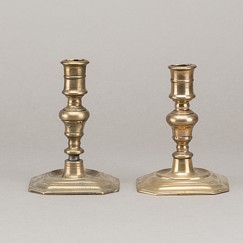 A set of two late Baroque brass candle sticks.