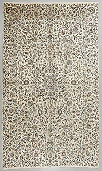 A Keshan rug, 396 x 290 cm.