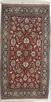 A Ghom rug, old, 286 x 155 cm.