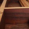 Finn juhl, a finn juhl rosewood 'judas' dining table, executed by niels vodder, denmark 1960's.