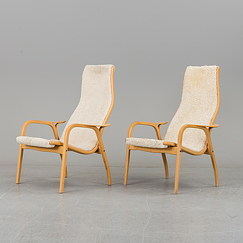 "YNGVE EKSTRÖM, a pair of ""Lamino"" armchairs by Yngve Ekström, Swedese."