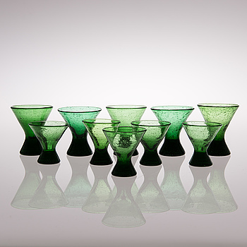 """A set of ten """"Vähän vino"""" (Slightly crooked) glasses, manufactured by Karhula in the 1930s."""