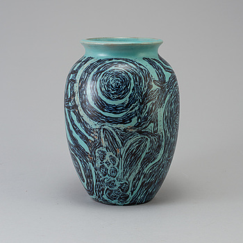 An earthenwere vase with undefined mark.