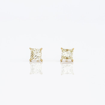 A pair of square princess cut diamond earrings.