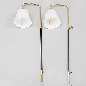 A pair of brass and leather wall lights by Blond Belysning, 2000's.