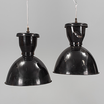 a pair of mid 20th century metal ceiling lights.