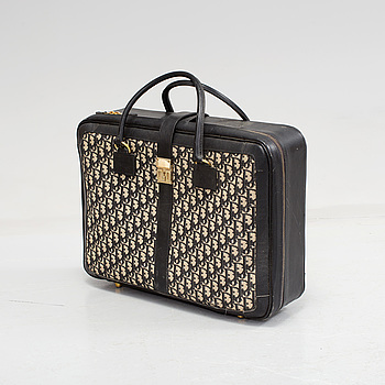 A Christian Dior monogram canvas and leather suitcase.