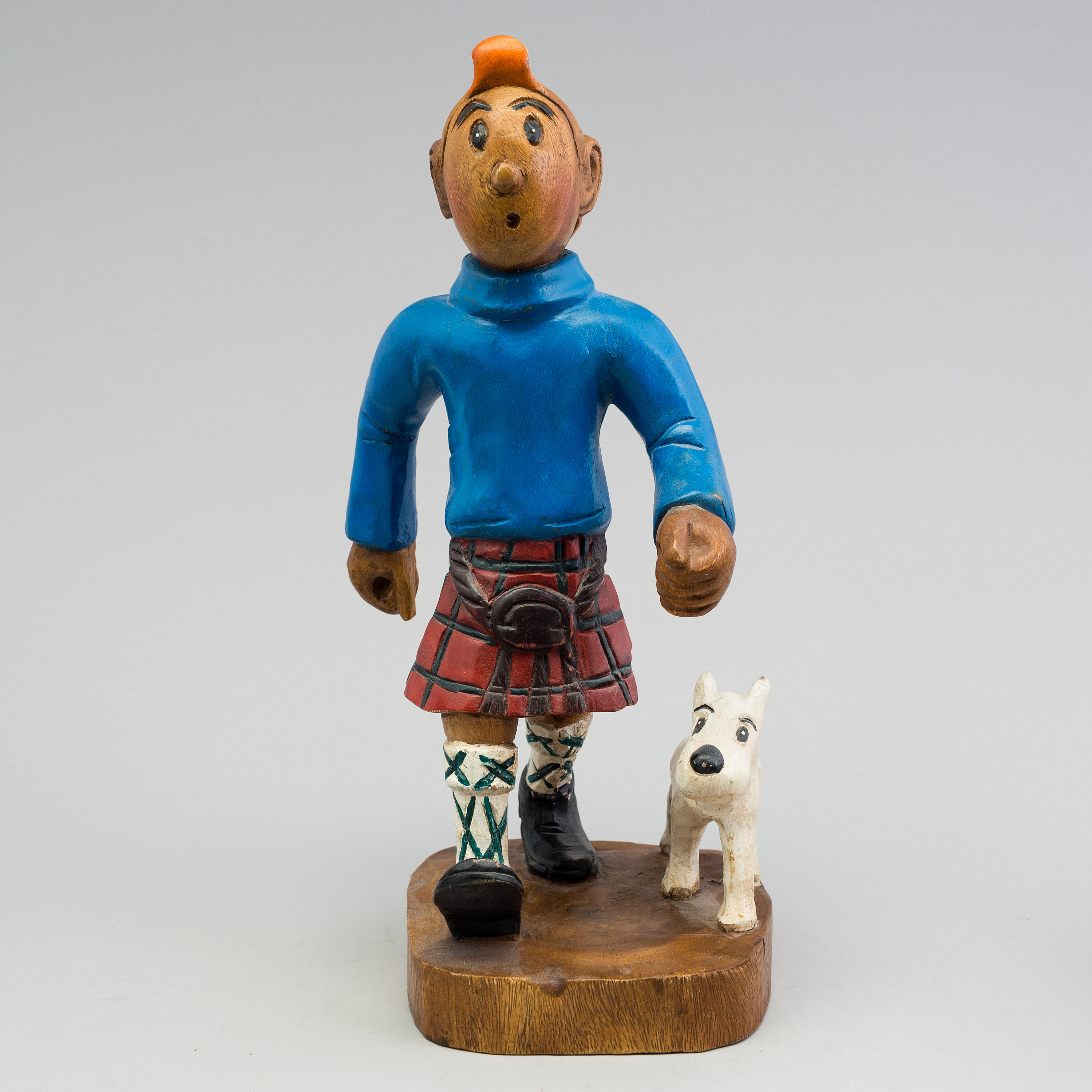 A Tintin And Snowy Wood Scuplture From The Second Half Of The 20th