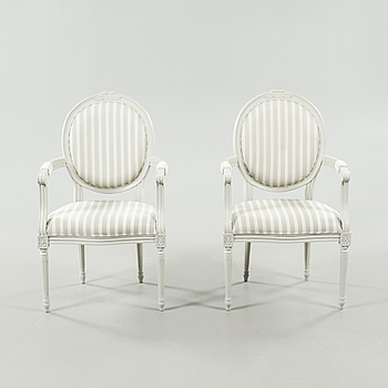 A pair of gustavian style arm chairs, second half of the 20th century.