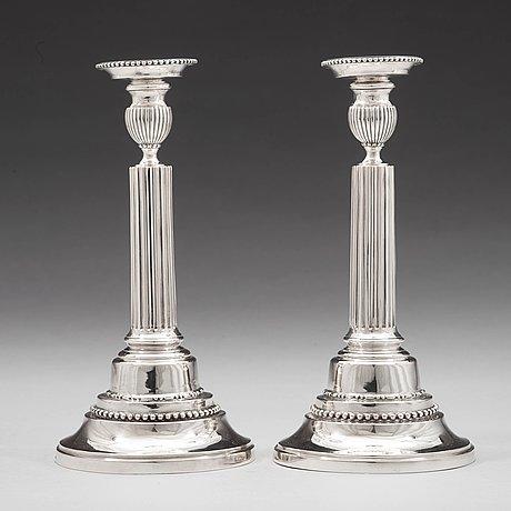A pair of swedish 18th century silver candlesticks, mark of johan ekholm, stockholm 1788.