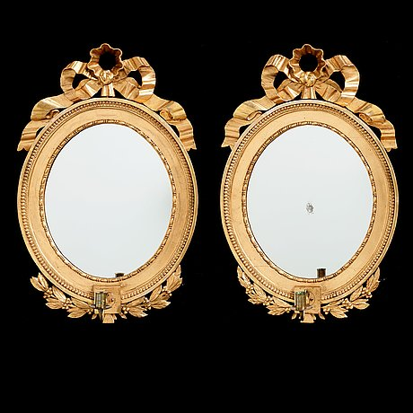 A pair of late gustavian early 19th century one light girandol mirrors