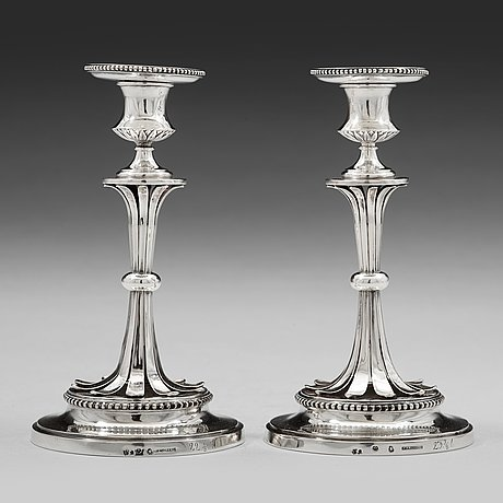 A pair of swedish 18th century silver candlesticks, mark of arvid floberg, stockholm 1788.