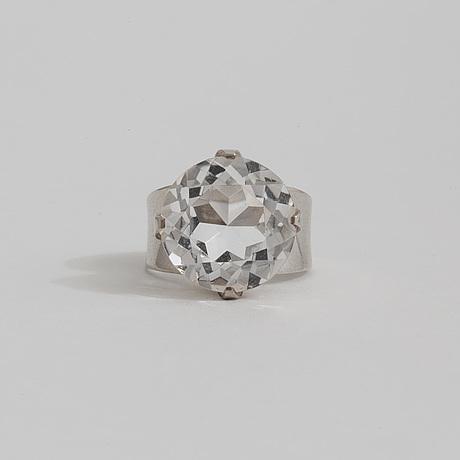 A rock crystal ring by  waldemar jonsson, skara, 1968