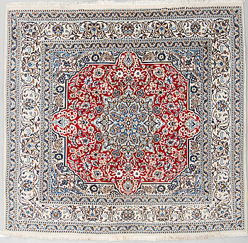 A part silk rug from Nain, around 186 x 196 cm.