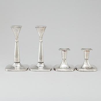 A set of 2+2 candlesticks, silver,  Tore Eldh, Göteborg, 1972.