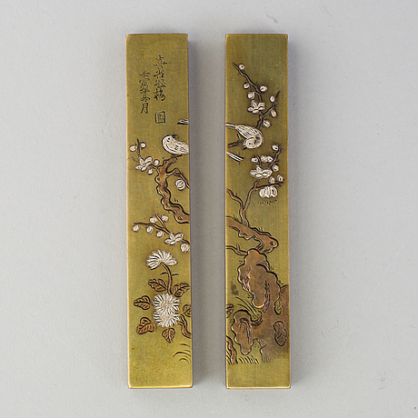 A pair of japanese scroll weights, early 20th century.