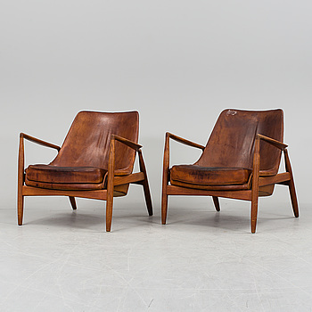 A pair of Ib Kofod Larsen 'Sälen/Seal' teak and brown leather easy chairs, Olof Person, Jönköping, Sweden 1950/60's.