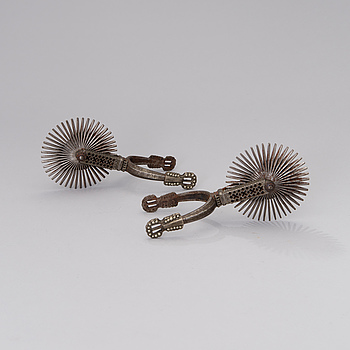 A pair of South-American gaucho spurs from around the turn of the 20th century.